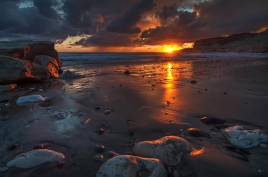 壯觀的海岸線落日圖片